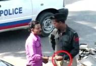 Police officer being bribe